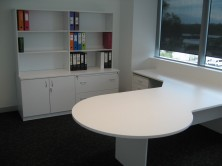Ecotech MM1 Desk Setting Showing Credenza And Overhead Bookcase In Back Ground