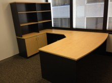 Ecotech Desk Setting. Bow Front Desk. Splayed Return. Back Credenza And Overhead Bookcase