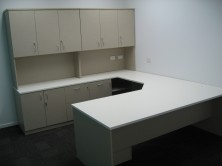 Custom Desk With Truncated Corner. Return With Special Back Credenza With Doors And Drawers. Overhead Hutch With Doors