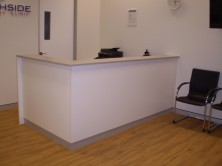 90 Degree Panel Front Reception Desk With Counter Top And Laminate Kick Skirt