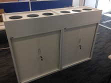 Photo Shows Tambour Door Cupboard With Planter Box On Top. White